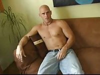 Blue-eyed hunk plays with his erect cock