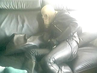 Dude In Leather Clothes & Gas Mask Abusing Himself