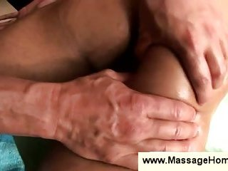 Gay masseur massages butt with his cock