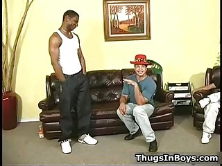 Latin dude gets his face all jizzed by two black studs