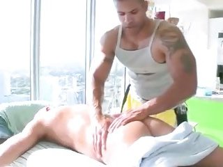 Ripped masseur stroking his clients cock with his strong hands