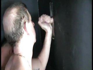 Lewd Guy Giving Head Through The Gloryhole