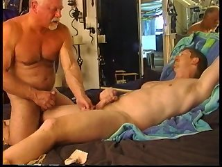 Hunky dude gets his balls worked over by very experienced top, part 2.